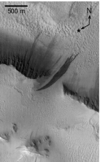 Image 2: An Image of the same area taken on 2002-06-10. A large new slope streak formed, while numerous other streaks persisted. North is up and illumination is from the lower left (Schorghofer et al. 2007).